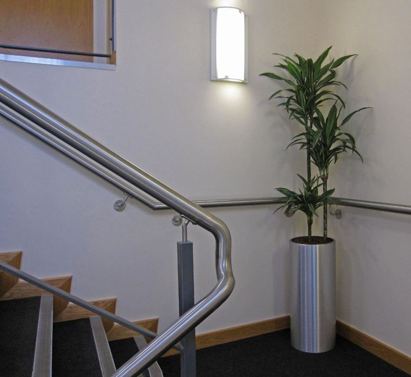 This tall circular plant display makes the main stairs to the first floor offices more welcoming