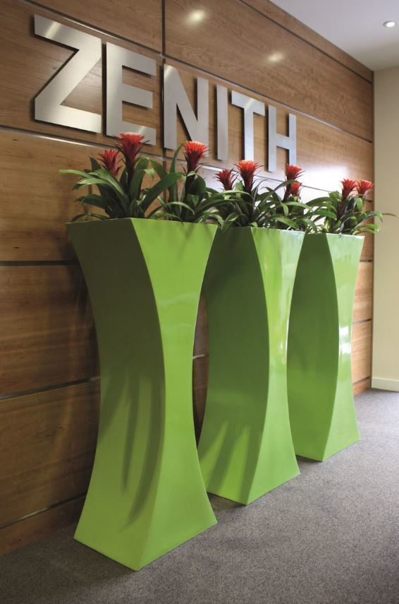 Curvy Sophia with flowering Plants in this West Midlands building Reception
