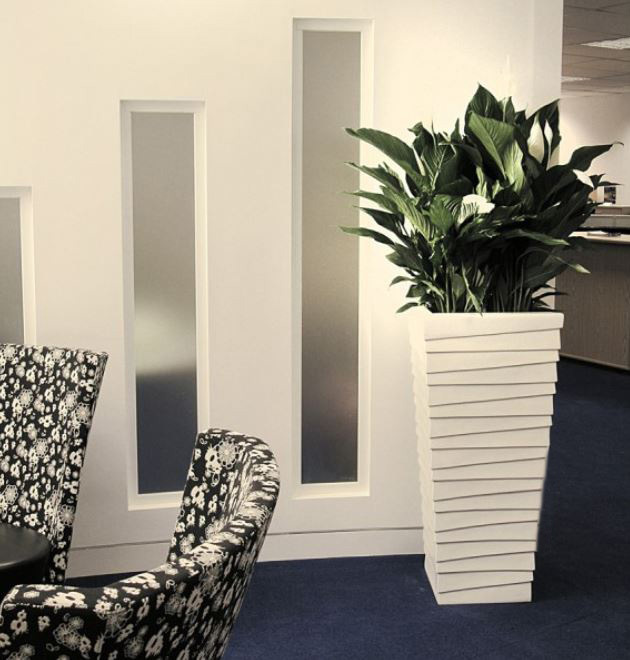 Groovy tall square Stack container with Spathyfyllum plant in this Nottingham office Breakout area