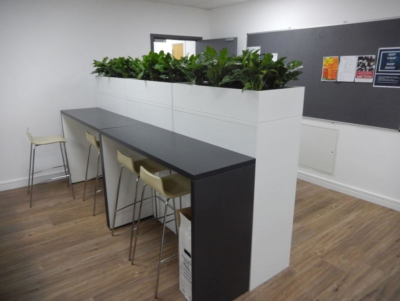 Cabinet top plant displays give privacy to this office breakout area
