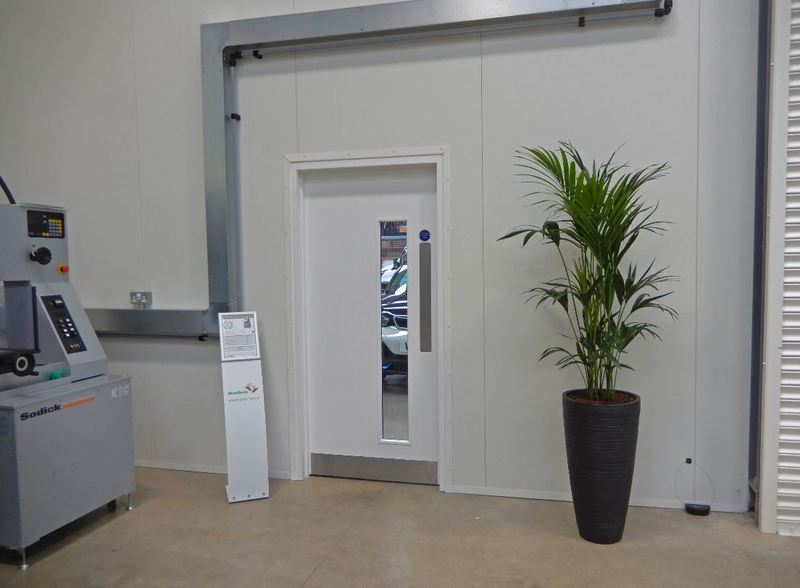 Tall Curved Vase with a Kentia Palm plant for this Nottingham factory HQ offices showroom