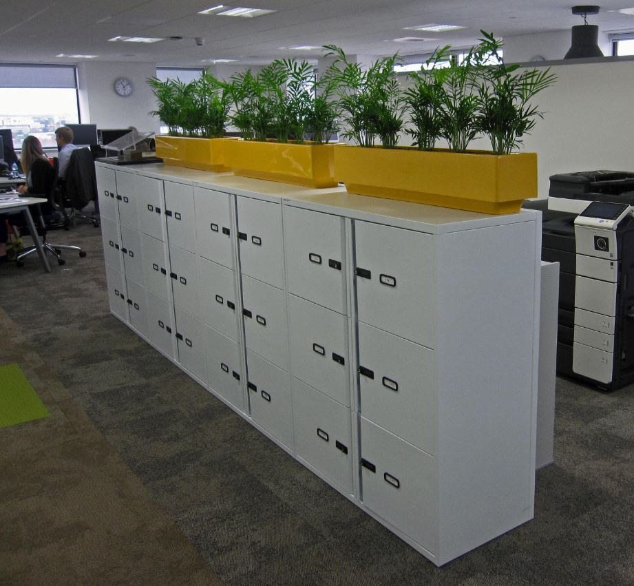 Cabinet top planters on the 17th floor of Birmingham office block