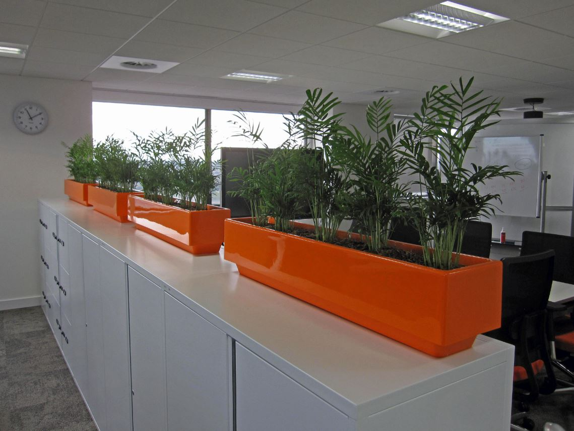 Retro 1970s orange cabinet top plant displays