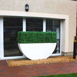 Artificial Buxus Hedging In A Tall Rectangular Planter For East Midlands Housing Scheme