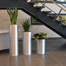 Tall Circular Metal Displays in Blythe Valley Business Park Reception